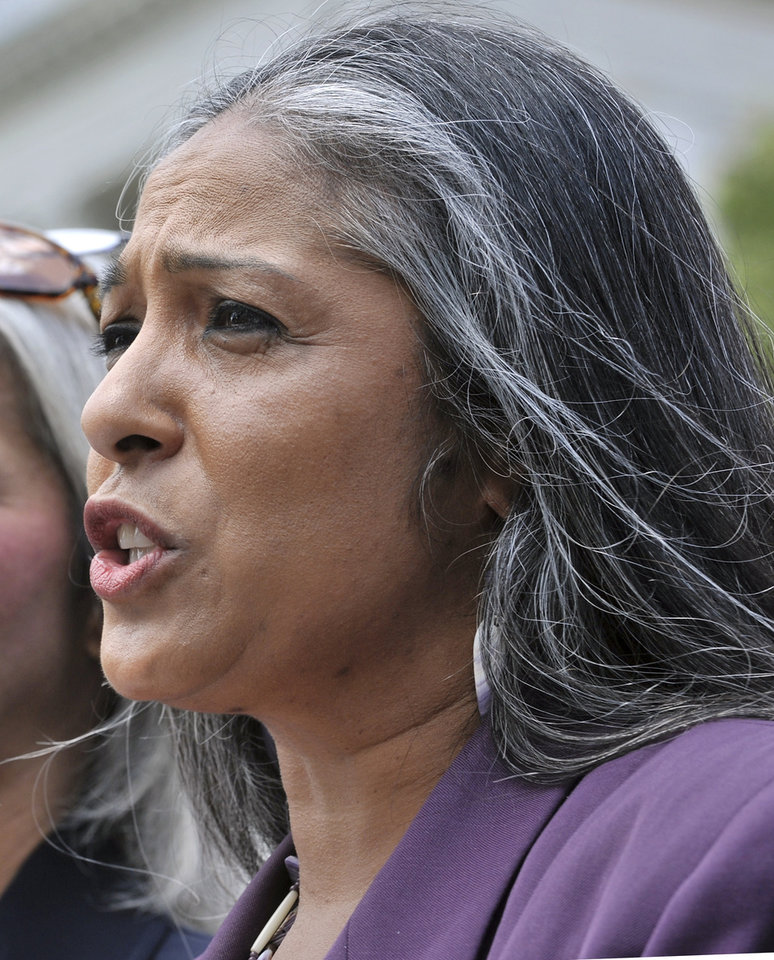 Photo - FILE - In this June 8, 2010, file photo, Cheryl Andrews-Maltais, former chairwoman of the Wampanoag Tribe and current chairwoman of the tribe's gaming corporation, speaks during a rally at the Statehouse in Boston. Andrews-Maltais said the tribe's proposal to turn an unfinished community center into a high-stakes bingo and poker hall represents the best chance for the financially struggling tribe to tap into tourist dollars that flow into the island each summer. (AP Photo/Josh Reynolds, File)