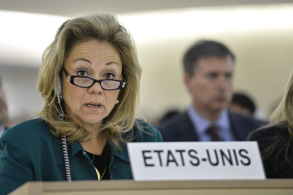 Photo -   Eileen Chamberlain Donahoe, U.S. Representative to the Human Rights Council, listens before the vote after the Syria draft resolution was just adopted by the Council during the 21th session of the Human Rights Council at the European headquarters of the United Nations in Geneva, Switzerland, Friday, Sept. 28, 2012. The U.N.'s top human rights body on Friday extended by six months the mission of its independent expert panel probing alleged war crimes in Syria's 18-month conflict. (AP Photo/Keystone, Martial Trezzini)