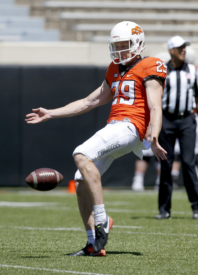 Photo - OSU's Tom Hutton punts the ball during the Oklahoma State Cowboys spring practice at Boone Pickens Stadium in Stillwater, Okla., Saturday, April 20, 2019.  Photo by Sarah Phipps, The Oklahoman