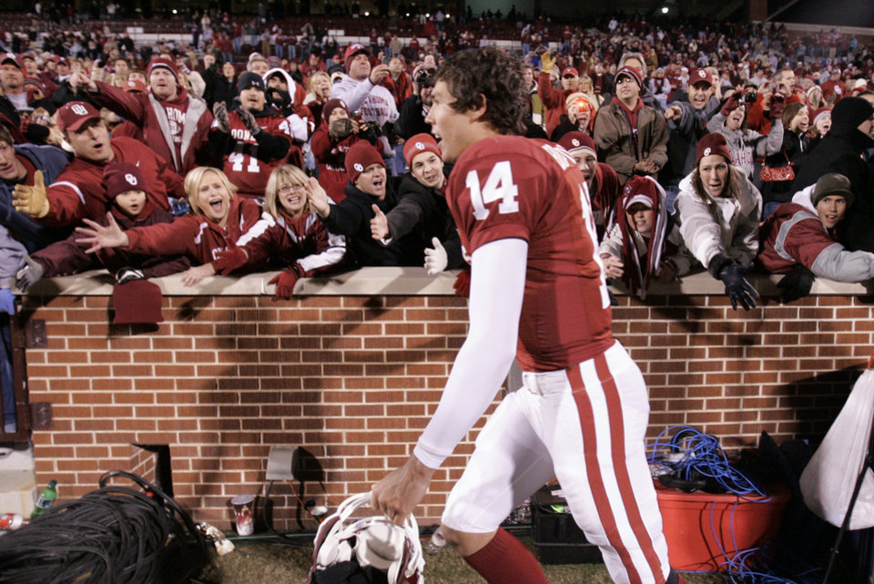 Photo - OU fans reach out to Sam Bradford following the college football game between the University of Oklahoma Sooners and Texas Tech University at the Gaylord Family -- Oklahoma Memorial Stadium on Saturday, Nov. 22, 2008, in Norman, Okla.   BY STEVE SISNEY, THE OKLAHOMAN