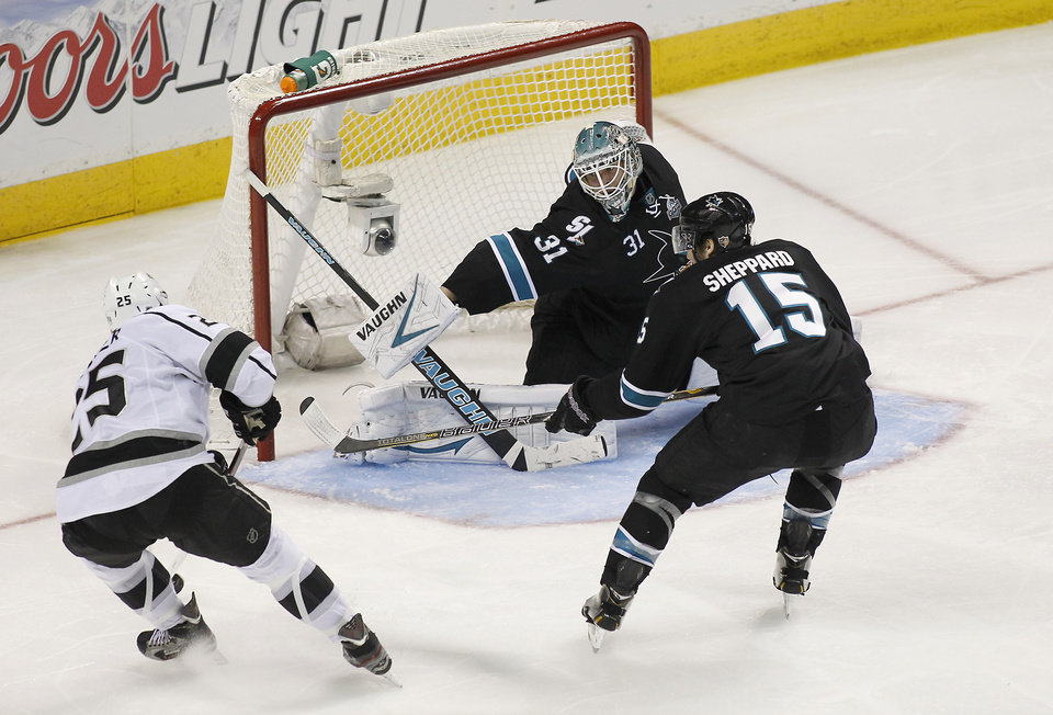 Photo - San Jose Sharks goalie Antti Niemi (31), of Finland, blocks a goal attempt against Los Angeles Kings left wing Dustin Penner (25) as San Jose Sharks center James Sheppard (15) defends during the third period in Game 3 of their second-round NHL hockey Stanley Cup playoff series, Saturday, May 18, 2013, in San Jose, Calif. (AP Photo/Tony Avelar)