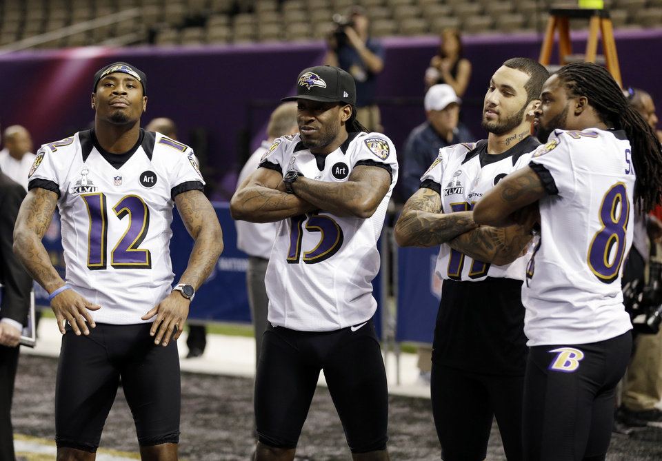 Baltimore Ravens wide receiver Jacoby Jones (12), LaQuan Williams (15), Tommy Streeter (11) and BTorrey Smith during media day for the NFL Super Bowl XLVII football game Tuesday, Jan. 29, 2013, in New Orleans. (AP Photo/Pat Semansky)