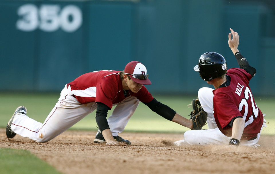 Photo - Dewey's Cody Robinson tags out Tuttle's Zac Wall during the class 4A state baseball championship game between Tuttle and Dewey at the Chickasaw Bricktown Ballpark in Oklahoma City, Saturday, May 17, 2014. Photo by Sarah Phipps, The Oklahoman