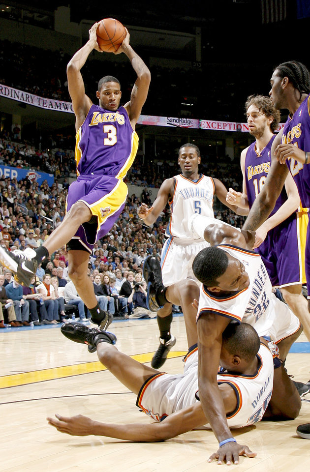 Photo - Oklahoma City's Kyle Weaver watches Trevor Ariza of the Lakers grabs a rebound as Oklahoma City's Jef Gren and Kevin Durant fall to the ground during the NBA basketball game between the Los Angeles Lakers and the Oklahoma City Thunder at the Ford Center,Tuesday, Feb. 24, 2009. The Thunder lost 107-93. PHOTO BY BRYAN TERRY, THE OKLAHOMAN