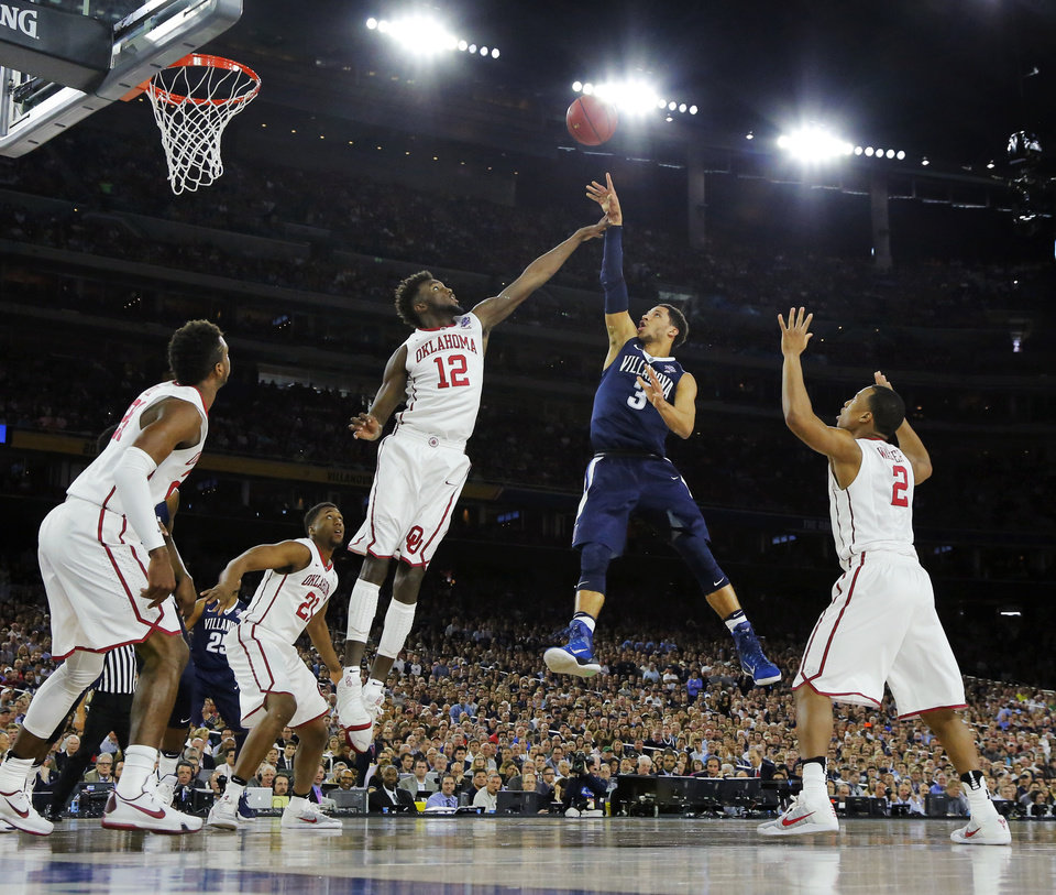 Photo - Villanova's Josh Hart (3) shoots against, from left, Oklahoma's Buddy Hield (24), Dante Buford (21), Khadeem Lattin (12) and Dinjiyl Walker (2) during the national semifinal between the Oklahoma Sooners (OU) and the Villanova Wildcats in the Final Four of the NCAA Men's Basketball Championship at NRG Stadium in Houston, Saturday, April 2, 2016. Photo by Nate Billings, The Oklahoman