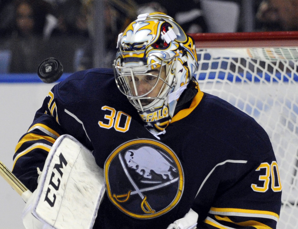 Photo - Buffalo Sabres' Ryan Miller makes a save against the Boston Bruins during the second period of an NHL hockey game in Buffalo, N.Y., Wednesday, Oct. 23, 2013. (AP Photo/Gary Wiepert)