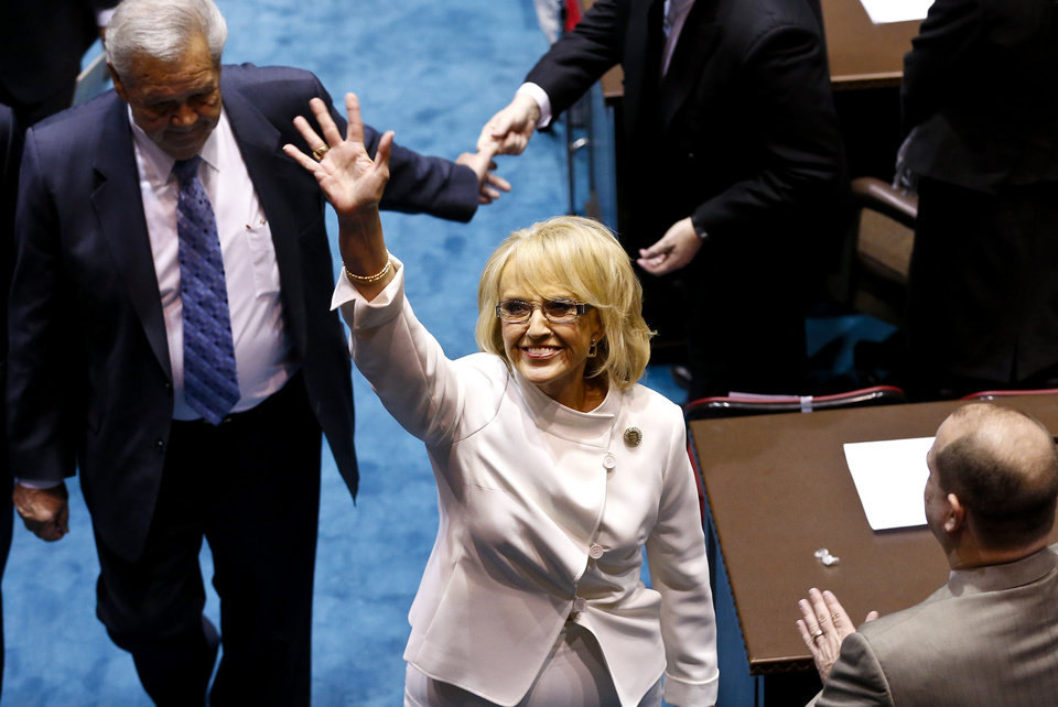 Arizona Gov. Jan Brewer waves to supporters in the gallery as she leaves the Arizona House of Representatives floor after giving her State of the State address at the Arizona Capitol, Monday, Jan. 14, 2013, in Phoenix.(AP Photo/Ross D. Franklin)