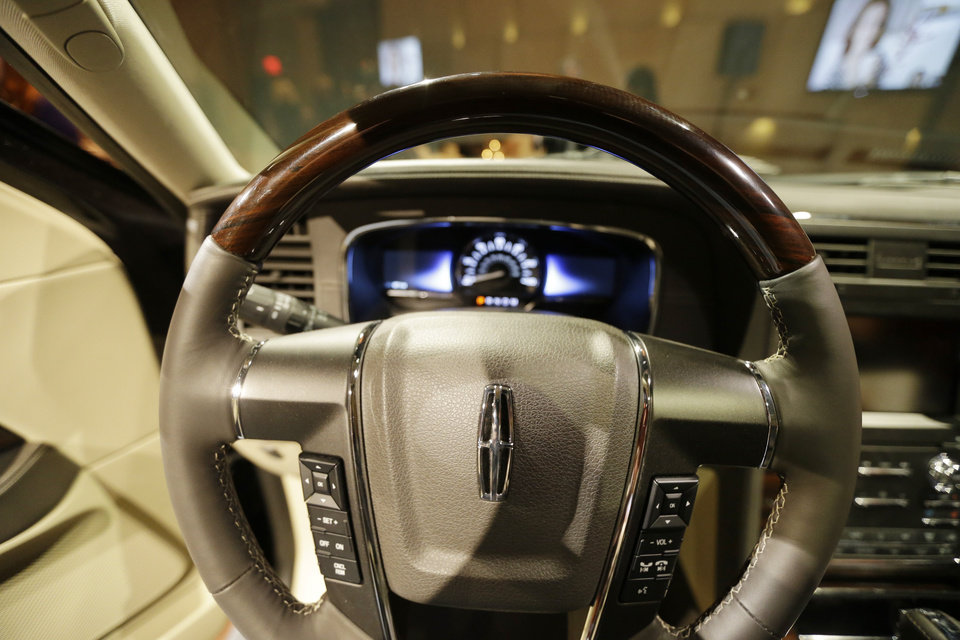 Photo - The console of the new 2015 Lincoln Navigator is unveiled in Detroit, Tuesday, Jan. 21, 2014. Lincoln Motor Co. _ Ford's luxury arm _ says the new Navigator will have more than 20 upgrades, from bigger wheels and a leather-wrapped steering wheel to a 3.5-liter EcoBoost V6 engine to replace its old V8. Lincoln plans to publicly unveil the vehicle at the Chicago Auto Show. The SUV _ which will be built in Kentucky _ goes on sale this fall. (AP Photo/Carlos Osorio)
