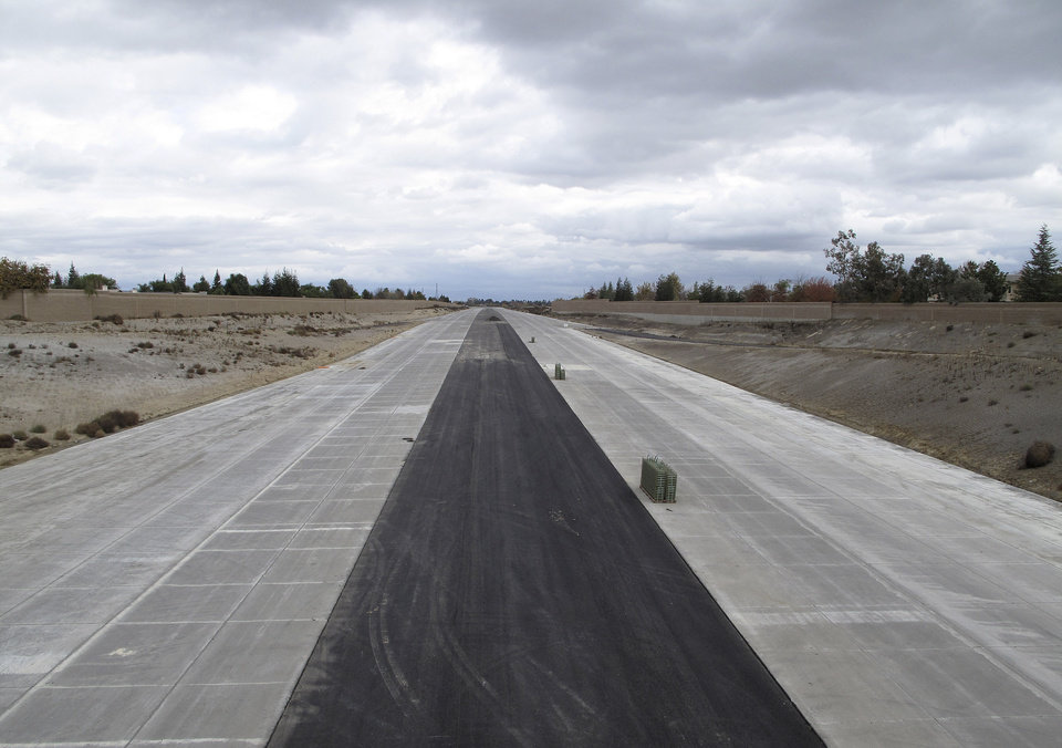 This Dec. 18, 2012 photo shows the Westside Parkway, a new east-west freeway that is nearing completion, in Bakersfield, Calif. Bakersfield is experiencing a building and jobs boom and the new Westside Parkway is designed to alleviate congestion there. (AP Photo/Tracie Cone)