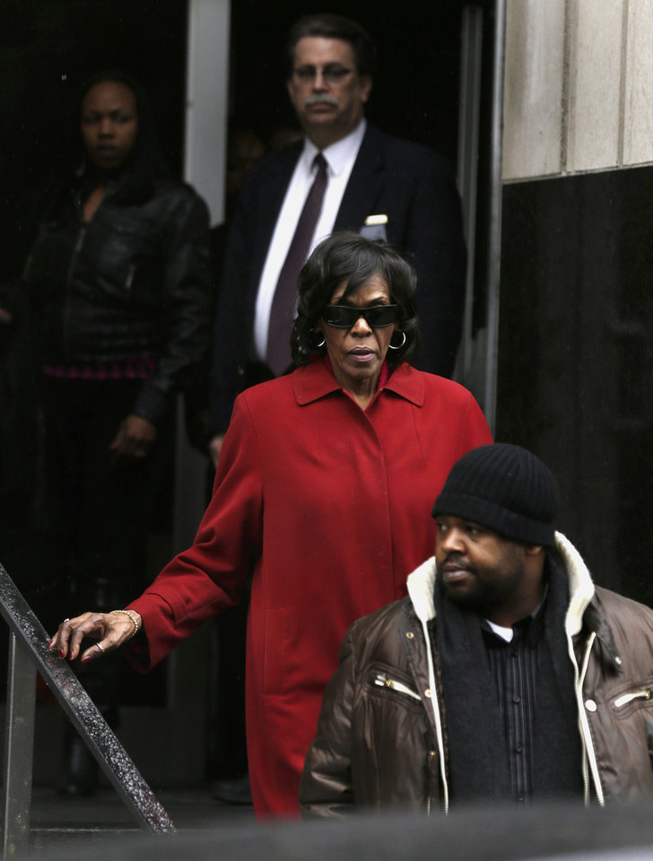 Photo - Former U.S. congresswoman Carolyn Cheeks Kilpatrick exits the Theodore Levin Federal U.S. Courthouse in Detroit, Monday, March 11, 2013. Her son, former Detroit Mayor Kwame Kilpatrick was convicted Monday of corruption charges and then sent to jail to await his prison sentence in yet another dramatic setback for a man who once was among the nation's youngest big-city leaders. Jurors convicted Kilpatrick of a raft of crimes, including racketeering conspiracy, which carries a maximum punishment of 20 years behind bars. Kilpatrick's long-time contractor friend, Bobby Ferguson was found guilty of 9 of 11 racketeering and extortion counts. Kwame Kilpatrick's father, Bernard Kilpatrick was convicted of 1 of 4 counts, including filing a false tax return. (AP Photo/Paul Sancya)