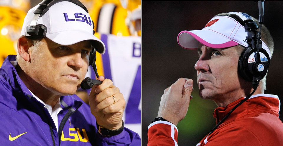 Photo - FILE - At left in an Oct. 19, 2013, file photo, LSU football coach Les Miles is shown during the second half of an NCAA college football game against Mississippi in Oxford, Miss. At right, also in an Oct. 19, 2013, file photo, Wisconsin coach Gary Andersen watches during the fourth quarter of an NCAA college football game against Illinois in Champaign, Ill. One school has declared it will use two quarterbacks. The other hasn't officially named a starter behind center. Welcome to the coaching chess match before the high-profile season opener between No. 14 Wisconsin and No. 13 LSU. (AP Photo/File)