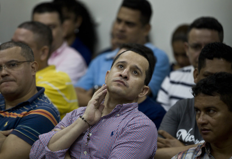 Henry Farinas gestures during the reading of his sentence on charges of money laundering in Managua, Nicaragua, Friday, Oct. 12, 2012. A Nicaraguan judge handed down a 30-year sentence for money-laundering to Farinas who was allegedly targeted when gunmen killed Argentine folk singer Facundo Cabral. Prosecutors say a trafficking gang believed Farinas had betrayed it and tried to kill him as he accompanied Cabral in a vehicle after a July 2011 concert in Guatemala that Farinas organized. (AP Photo/Esteban Felix)