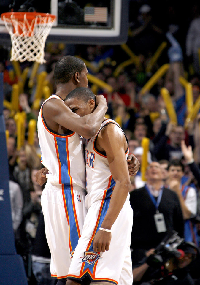 Photo - Oklahoma City's Kevin Durant (35) and Russell Westbrook (0) celebrate a point during the NBA basketball game between the Oklahoma City Thunder and the Portland Trailblazers, Sunday, March 27, 2011, at the Oklahoma City Arena. Photo by Sarah Phipps, The Oklahoman