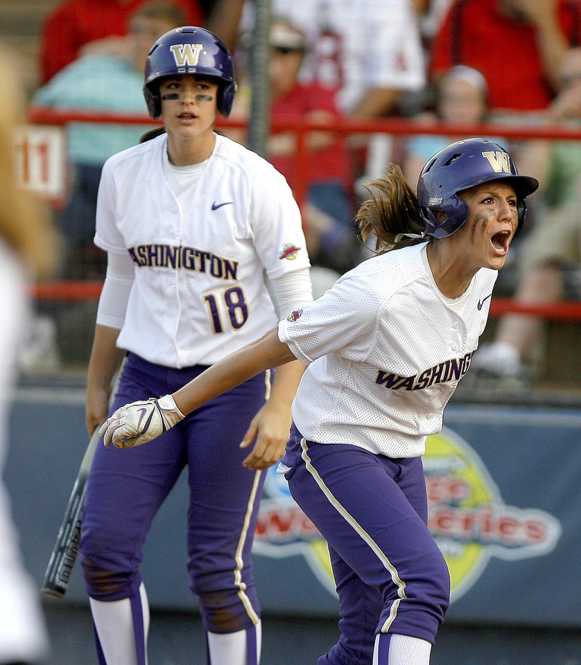 Photo - COLLEGE SOFTBALL / REACTION: University of Washington's Kimi Pohlman, right, reacts after scoring as Morgan Stuart watches in the first inning during the second softball game of the championship series between Washington and Florida in Women's College World Series at ASA Hall of Fame Stadium in Oklahoma City, Tuesday, June 2, 2009. Photo by Bryan Terry, The Oklahoman ORG XMIT: KOD