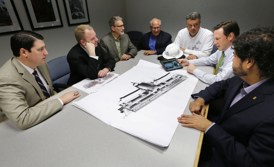 Photo -  A team of architects and engineers producing a 3D map of the state Capitol discuss one of the maps at the the facility Friday in Oklahoma City. From left are Trait Thompson, Brian Sauer, Steve Scovel, Fred Schmidt, Kyle Nelson, David Ketch, and Xavier Neira. The results of the mapping will be used to guide the Capitol's biggest-ever remodel and repair project. Photo by Paul Hellstern, The Oklahoman   PAUL HELLSTERN -  Oklahoman