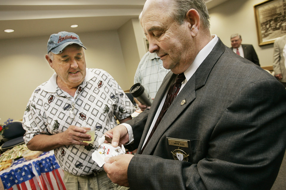 Sheriff DeWayne Beggs gets a fishing lure from his friend Bill Tucker at his retirement party at the Cleveland County Office Building Wed. April 30, 2008 in Norman, Ok. BY JACONNA AGUIRRE/THE OKLAHOMAN
