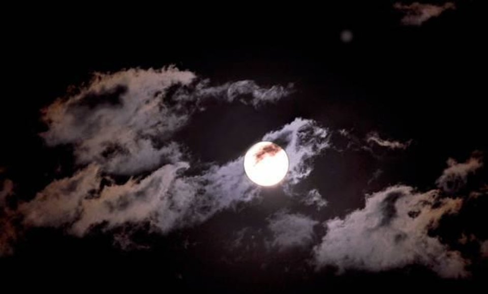 Photo - Clouds pass in front of a full moon on an autumn night in Oklahoma on Nov. 21, 2010. Photo by Jim Beckel, The Oklahoman
