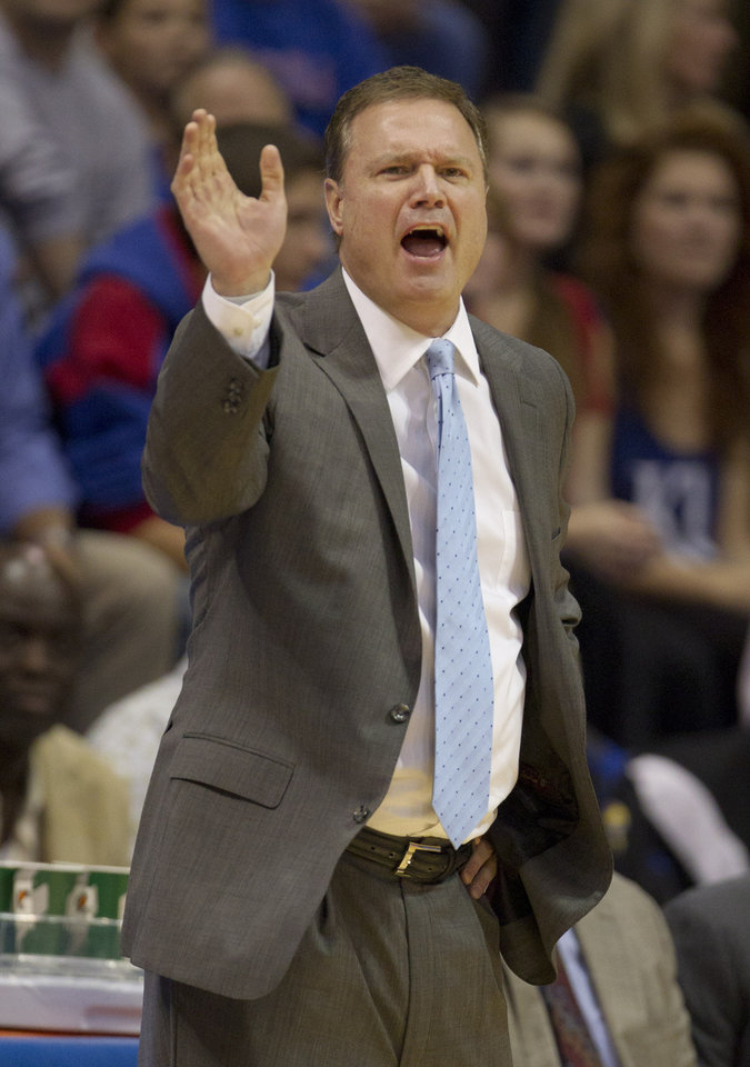 Kansas coach Bill Self directs his team during the first half of an NCAA college basketball game against Chattanooga in Lawrence, Kan., Thursday, Nov. 15, 2012. (AP Photo/Orlin Wagner)