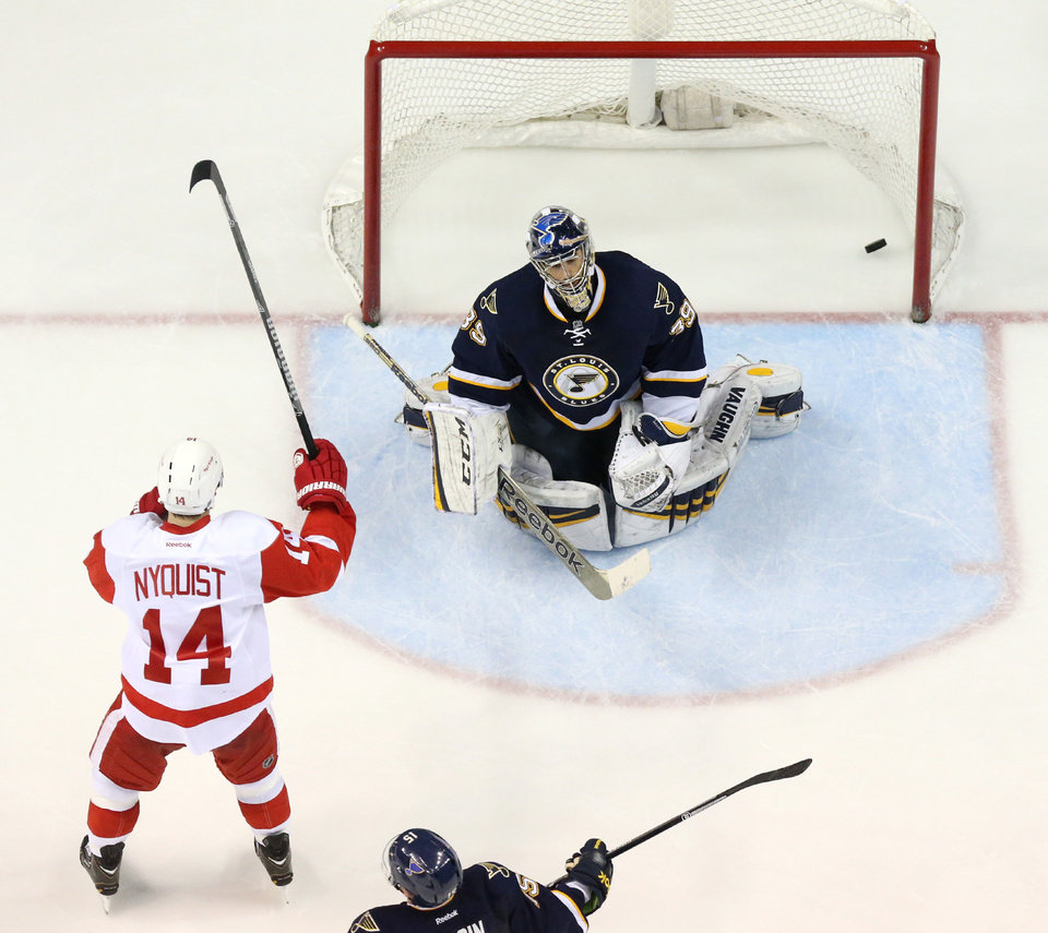 Photo - Detroit Red Wings right wing Gustav Nyquist, left, reacts after teammate Justin Abdelkader scored against St. Louis Blues goaltender Ryan Miller during the third period of an NHL hockey game Sunday, April 13, 2014, in St. Louis. Detroit won 3-0. (AP Photo/St. Louis Post-Dispatch, Chris Lee) EDWARDSVILLE OUT  ALTON OUT