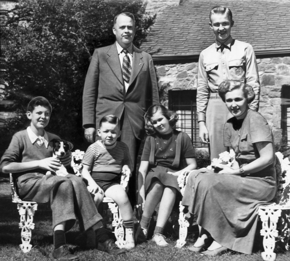 "ROBERT S KERR / CANDIDATE FOR GOVERNOR / OKLAHOMA / FAMILY:  ""Christmas week will be a gala time in the Robert S. Kerr home, northeast of the city, for Robert S. Kerr Jr., standing, right, a student at New Mexico Military Institute, Roswell, will be home for the holidays.  Mrs. Kerr, seated, right, and the youngest son of the family, Bill, second from left, were in Roswell for a pre-Thanksgiving visit recently.  Aiding in the welcome for Cadet Robert, will be his sister, Kay, seated next to Mrs. Kerr, and Breene, far left.  Mr. Kerr is standing, left."" Staff photo ran in the 11/30/1941 Daily Oklahoman and the 7/15/1942 Oklahoma City Times."
