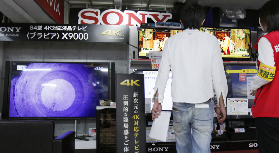 Photo - A customer visits a Tokyo electronics store to check out Sony's Bravia 4K flat-panel TVs in Tokyo, Thursday, May 9, 2013. Sony Corp. is back in the black for the fiscal fourth quarter, recording a 93.9 billion yen ($948 million) profit, with big help from a weaker yen that boosts overseas earnings. (AP Photo/Koji Sasahara)