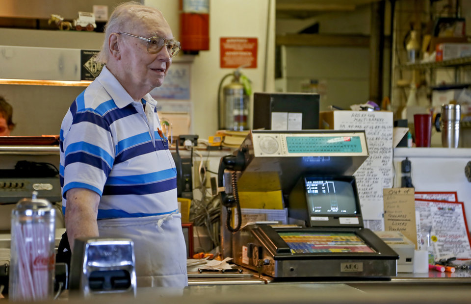Photo - Owner Johnny Ballard works the counter at Ballard's Drive-In located in Pauls Valley, Okla. Monday, July 16, 2012.   Photo by Chris Landsberger, The Oklahoman