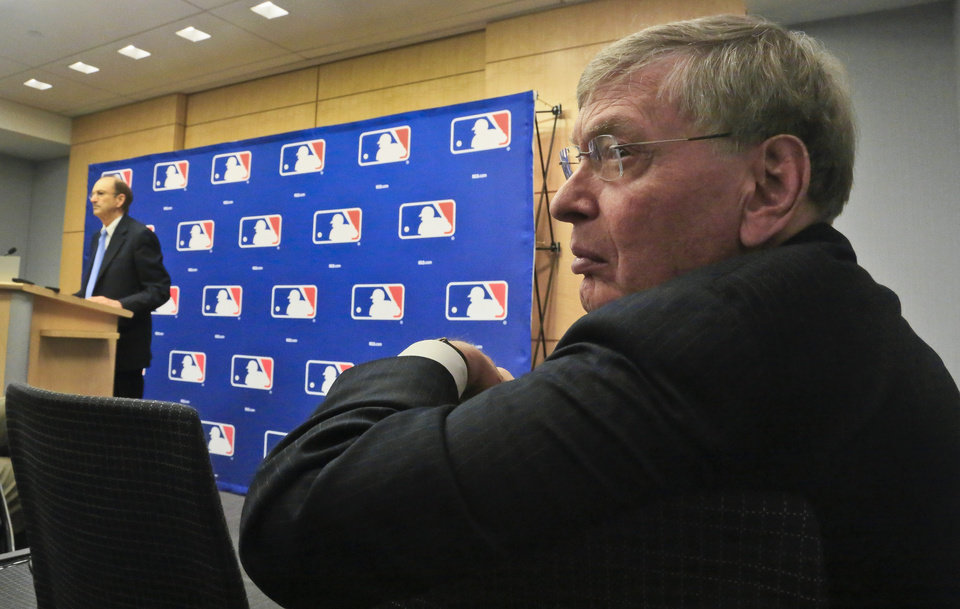 Photo - Major League Baseball Commissioner Bud Selig, right, listens as St. Louis Cardinals chairman Bill DeWitt, left, fields questions during a press conference, Thursday, May 15, 2014 at MLB headquarters in New York.  DeWitt was appointed chairman of a succession committee to determine the process for replacing Selig, who has headed baseball since 1992 and plans to retire in January 2015.  (AP Photo/Bebeto Matthews)