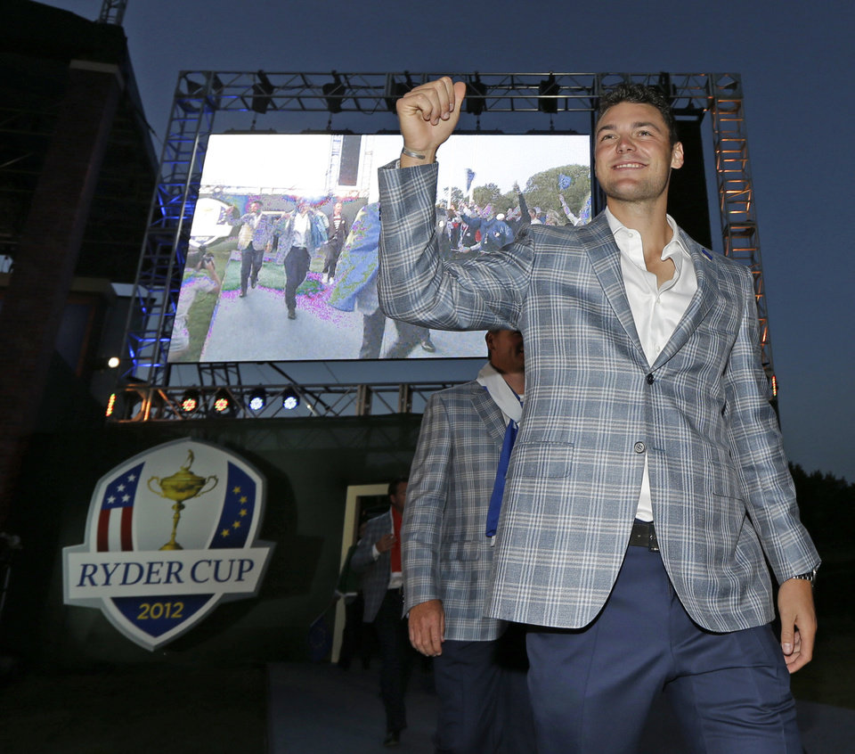 Photo - Europe's Martin Kaymer arrives at the closing ceremony for the Ryder Cup PGA golf tournament Sunday, Sept. 30, 2012, at the Medinah Country Club in Medinah, Ill. (AP Photo/David J. Phillip)  ORG XMIT: PGA245