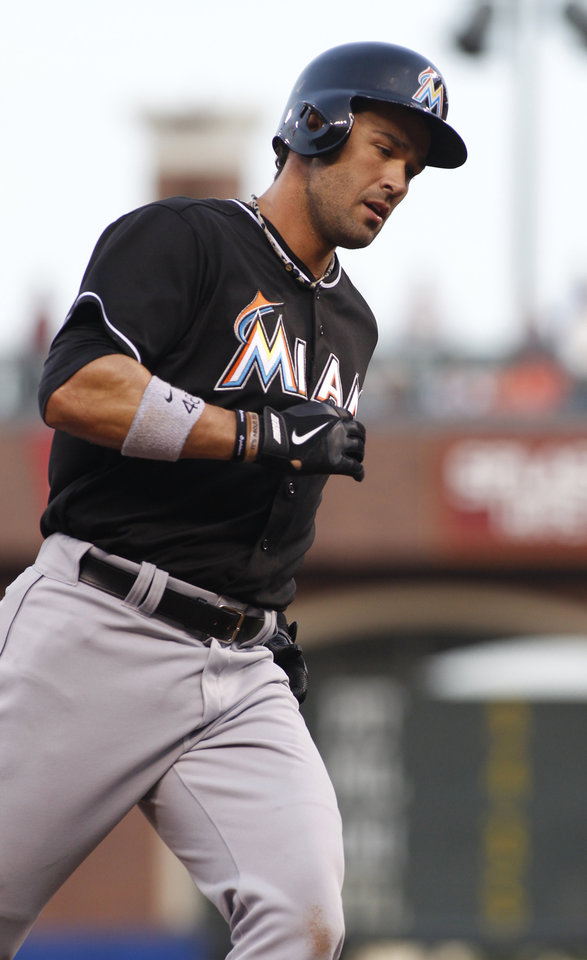 Photo - Miami Marlins' Garrett Jones rounds third base after hitting a two run homer against the San Francisco Giants during the second inning of a baseball game, Thursday, May 15, 2014, in San Francisco. (AP Photo/George Nikitin)