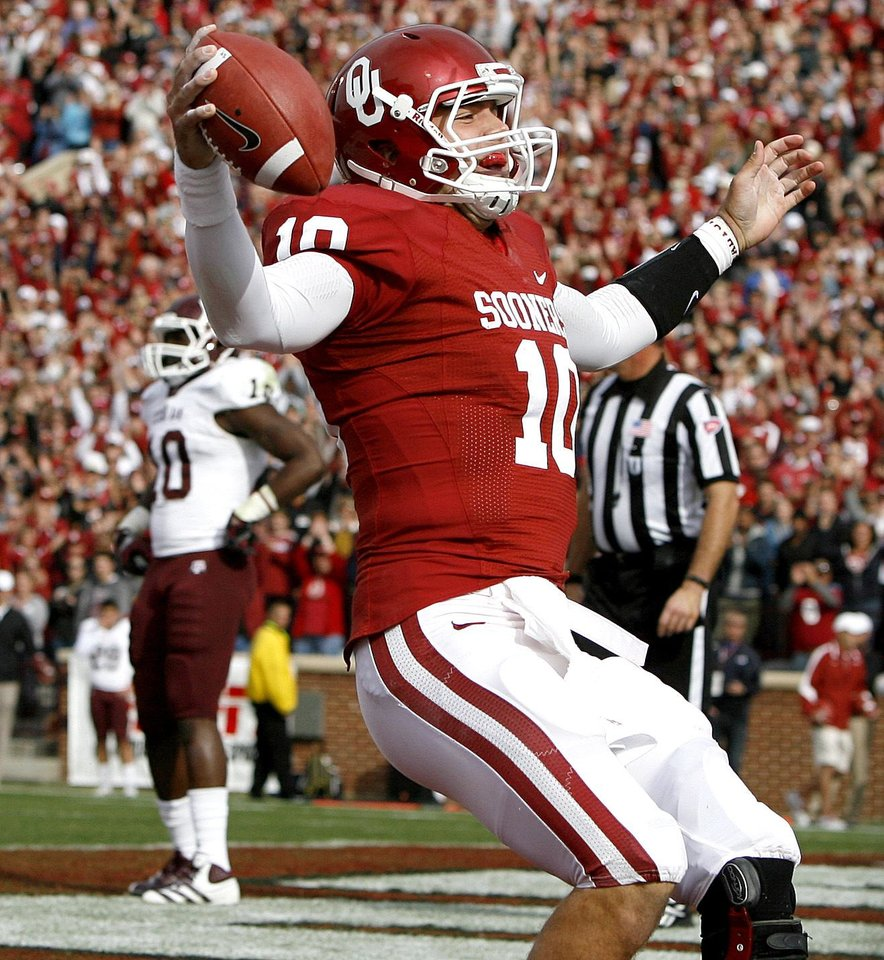 Photo - Oklahoma's Blake Bell (10) reacts after running for a touchdown during the college football game between the Texas A&M Aggies and the University of Oklahoma Sooners (OU) at Gaylord Family-Oklahoma Memorial Stadium on Saturday, Nov. 5, 2011, in Norman, Okla. Oklahoma won 41-25. Photo by Bryan Terry, The Oklahoman