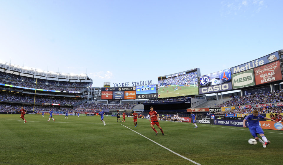 Photo -   Chelsea FC's Kevin de Bruyne, right, puts a shot on-goal during the first half of an exhibition soccer match against Paris Saint-Germain at Yankee Stadium in New York, Sunday, July 22, 2012. (AP Photo/Henny Ray Abrams)