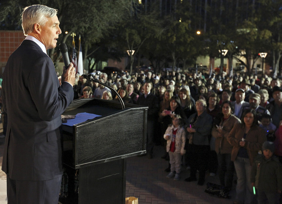 Midland Mayor Wes Perry speaks during a candlelight vigil held at Centennial Plaza in Midland, Texas on Saturday, Nov. 17, 2012 in honor of the people involved in an accident where a Union Pacific train struck a float carrying military veterans on Thursday, Nov. 15, 2012. Four veterans were killed, including one from the San Antonio area. (AP Photo/San Antonio Express-News, Edward A. Ornelas)