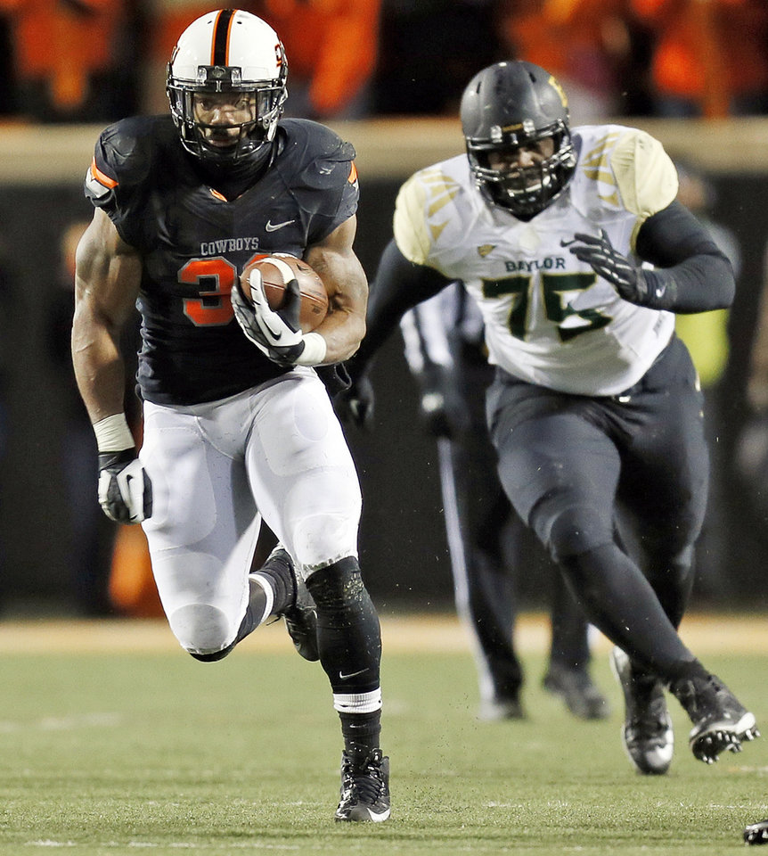 Oklahoma State's Jeremy Smith (31) carries the ball away from Baylor's Andrew Billings (75) during a college football game between the Oklahoma State University Cowboys (OSU) and the Baylor University Bears (BU) at Boone Pickens Stadium in Stillwater, Okla., Saturday, Nov. 23, 2013. OSU won, 49-17. Photo by Nate Billings, The Oklahoman