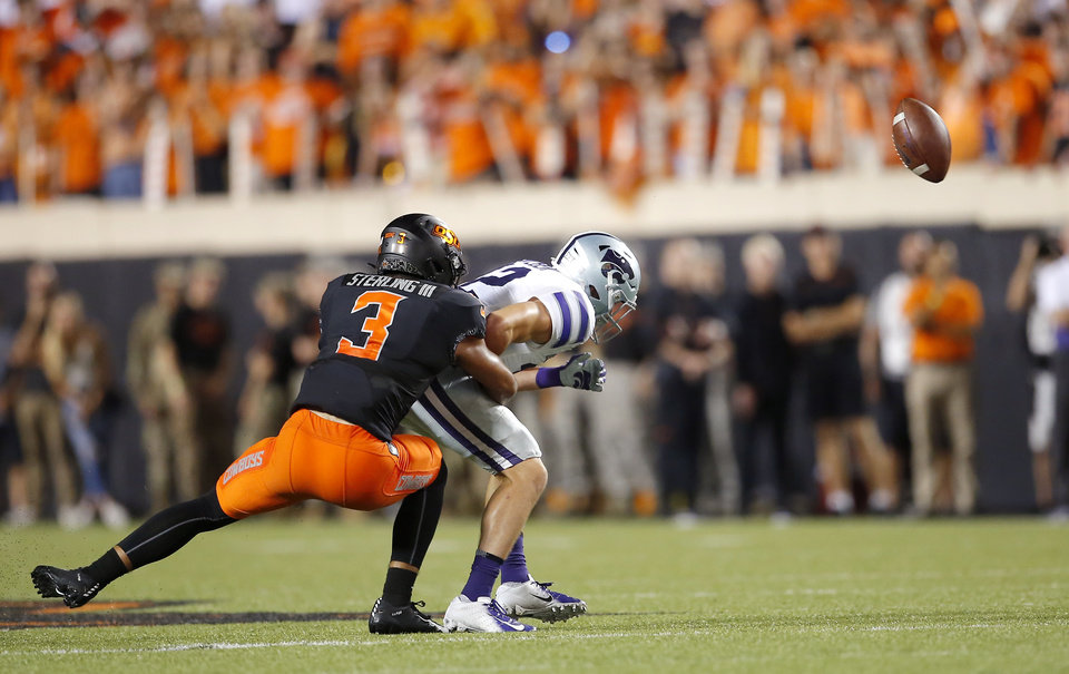 Photo - Oklahoma State's Tre Sterling (3) breaks up a pass intended for Landry Weber (12) in the third quarrter during the college football game between the Oklahoma State Cowboys and the Kansas State Wildcats at Boone Pickens Stadium in Stillwater, Okla., Saturday, Sept. 28, 2019. [Sarah Phipps/The Oklahoman]