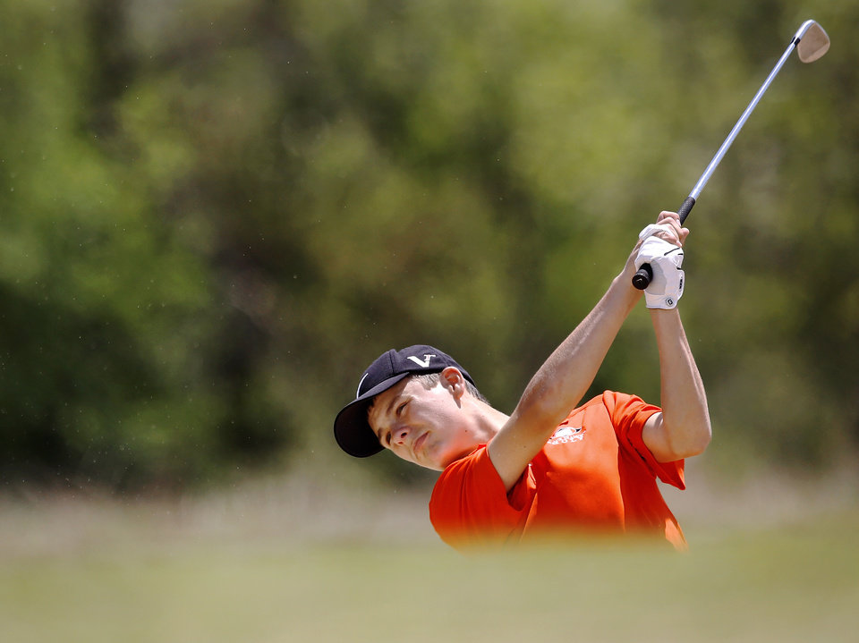 Photo - Nick Pierce of Sallisaw High School, hits out of a bunker on hole #16 during Class 4A boy's state golf  tournament on Tuesday, May 7, 2013,  at  Hefner Golf Course in Oklahoma City.   Photo  by Jim Beckel, The Oklahoman.