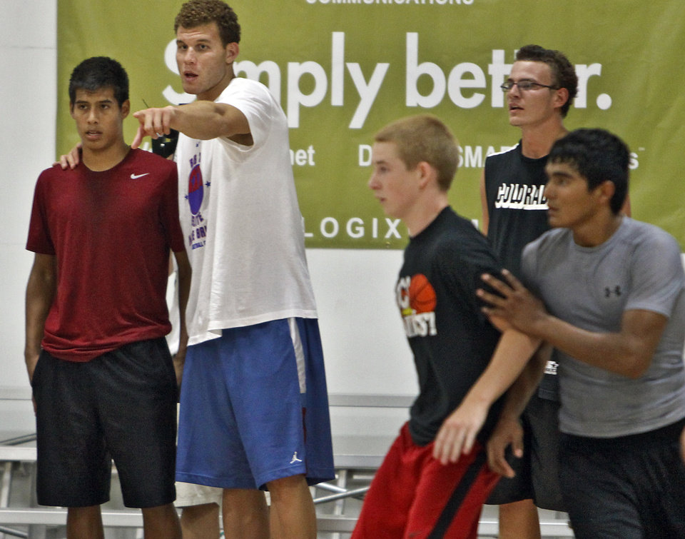 Photo - Los Angeles Clippers Blake Griffin works with campers during his basketball camp held at the Santa Fe Family Life Center on Wednesday, Aug. 2, 2011, in Oklahoma City, Okla. Photo by Chris Landsberger, The Oklahoman