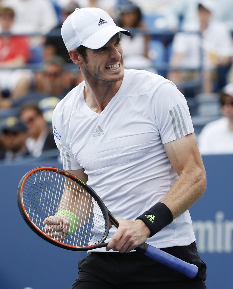 Photo - Andy Murray, of the United Kingdom, reacts after a shot against Andrey Kuznetsov, of Russia, during the third round of the 2014 U.S. Open tennis tournament, Saturday, Aug. 30, 2014, in New York. (AP Photo/Kathy Willens)