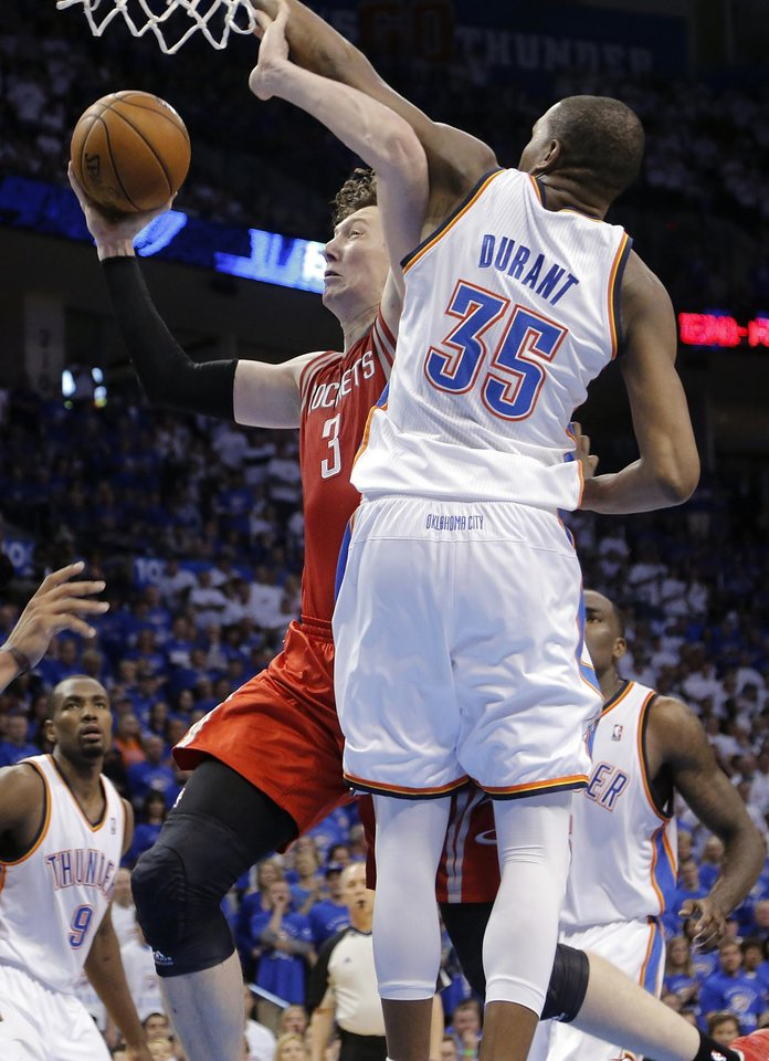 Oklahoma City's Kevin Durant (35) defends on Houston's Omer Asik (3) during Game 2 in the first round of the NBA playoffs between the Oklahoma City Thunder and the Houston Rockets at Chesapeake Energy Arena in Oklahoma City, Wednesday, April 24, 2013. Photo by Chris Landsberger, The Oklahoman