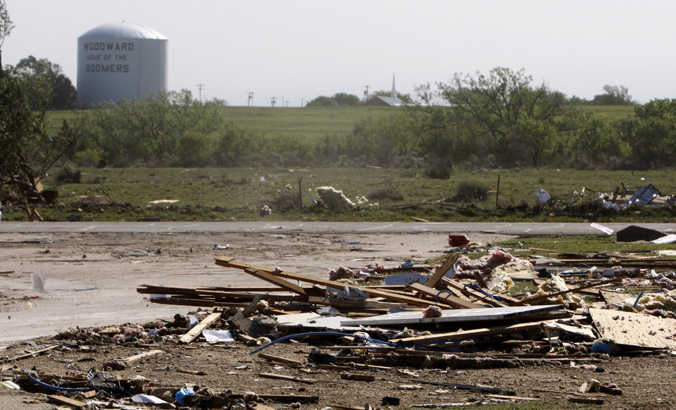 Photo - The Woodward water tower is seen in Woodward, Okla., Sunday, April 15, 2012. A tornado that killed five people struck Woodward, Okla., shortly after midnight on Sunday, April15, 2012.  Photo by Bryan Terry, The Oklahoman