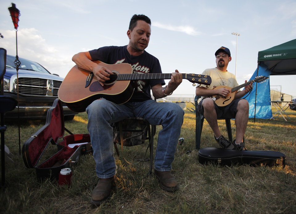 Photo - Ross Johnson and Jeff Clanton play music near their camp during the Woody Guthrie Folk Festival in Okemah, Okla., Thursday, July 12, 2012.  Photo by Garett Fisbeck, The Oklahoman
