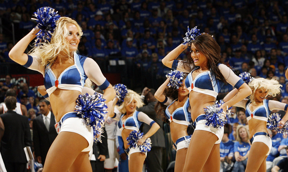 Photo - The Thunder Girls dance team performs in the first half during game one of the Western Conference semifinals between the Memphis Grizzlies and the Oklahoma City Thunder in the NBA basketball playoffs at Oklahoma City Arena in Oklahoma City, Sunday, May 1, 2011. Photo by Nate Billings, The Oklahoman
