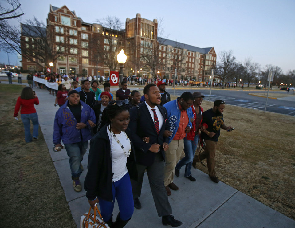 Photo - Above:  Students march Tuesday across the University of Oklahoma  campus to the Sigma Alpha  Epsilon fraternity house in  Norman in reaction to a racist bus incident involving members of the fraternity.  Photo by Bryan Terry,  The Oklahoman  Bryan Terry