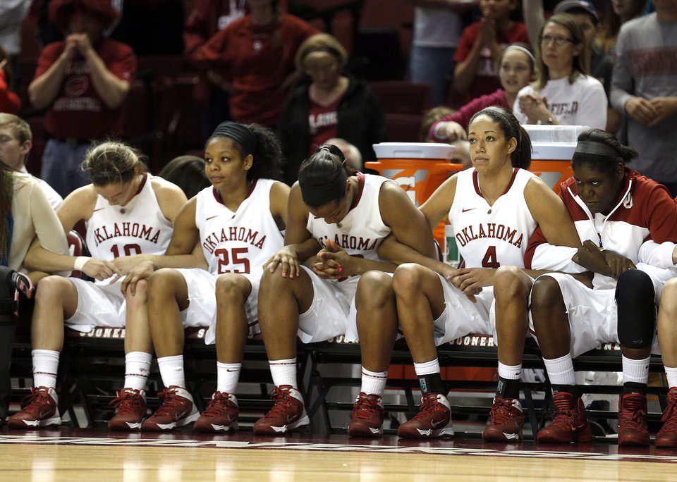 Photo - The Oklahoma bench watches the final free throw during the women's basketball game between, University of Oklahoma and West Virginia, Thursday, Feb. 13, 2014, in Norman, Okla. Photo by Sarah Phipps, The Oklahoman