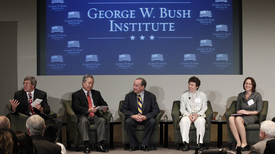 Photo - Stephen Moore, left, leads a panel with, from left, Robert Asahina, Clint Bolick, Jennifer Hunt and Pia Orrenius at the Federal Reserve Bank of Dallas for a conference titled