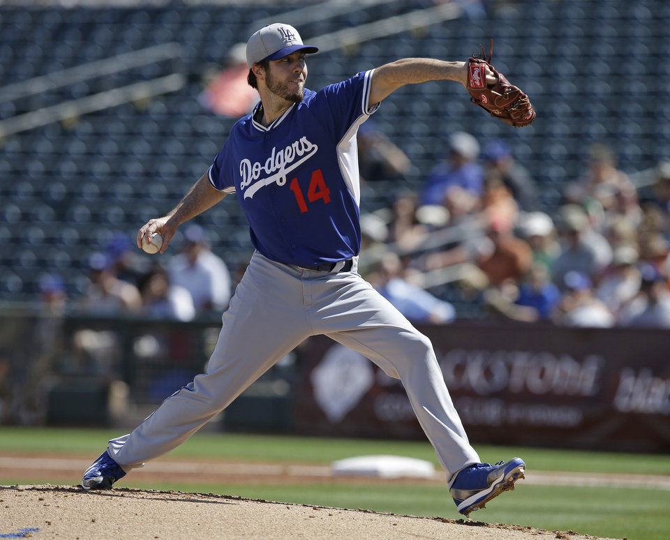 Photo - CORRECTS SPELLING OF SURPRISE - Los Angeles Dodgers starting pitcher Dan Haren throws during the first inning of an exhibition baseball game against the Kansas City Royals on Tuesday, March 11, 2014, in Surprise, Ariz. (AP Photo/Darron Cummings)