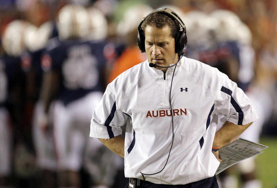FILE - In this Sept. 22, 2012, file photo, Auburn coach Gene Chizik walks the sidelines near the end of a 12-10 loss to LSU in the second half of an NCAA college football game at Jordan-Hare Stadium in Auburn, Ala. Five games into the season, Chizik is still seeking a starting quarterback, fixes for a dreadfully unproductive offense and win No. 2. (AP Photo/Dave Martin, File) ORG XMIT: NY155