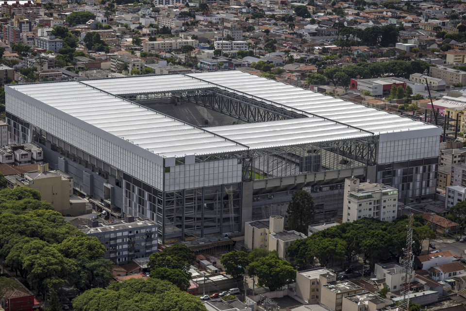 Photo - This March 20, 2014 photo released by Portal da Copa, shows an aerial view of the Arena da Baixada in Curitiba, Brazil. It's all coming down to the final 30 days. Brazil had seven years to get ready for the World Cup, but it enters the final month of preparations with a lot yet to be done. The unfinished stadium in Brazil's southern city of Curitiba, was nearly excluded from the tournament by FIFA earlier this year. The first full test at the venue is scheduled for this week.(AP Photo/Portal da Copa, Alexandre Carnieri)