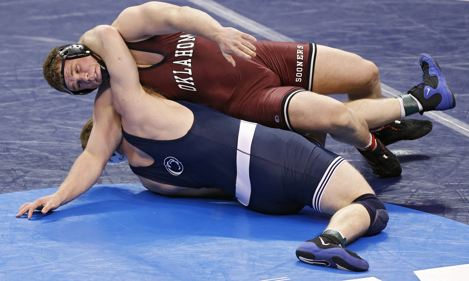 Photo - Oklahoma's Ross Larson takes on Penn State's Jonathan Gingrich in the 285 pound match during the 2014 NCAA Div. 1 Wrestling Championships at Chesapeake Energy Arena in Oklahoma City, Okla. on Friday, March 21, 2014. Photo by Chris Landsberger, The Oklahoman