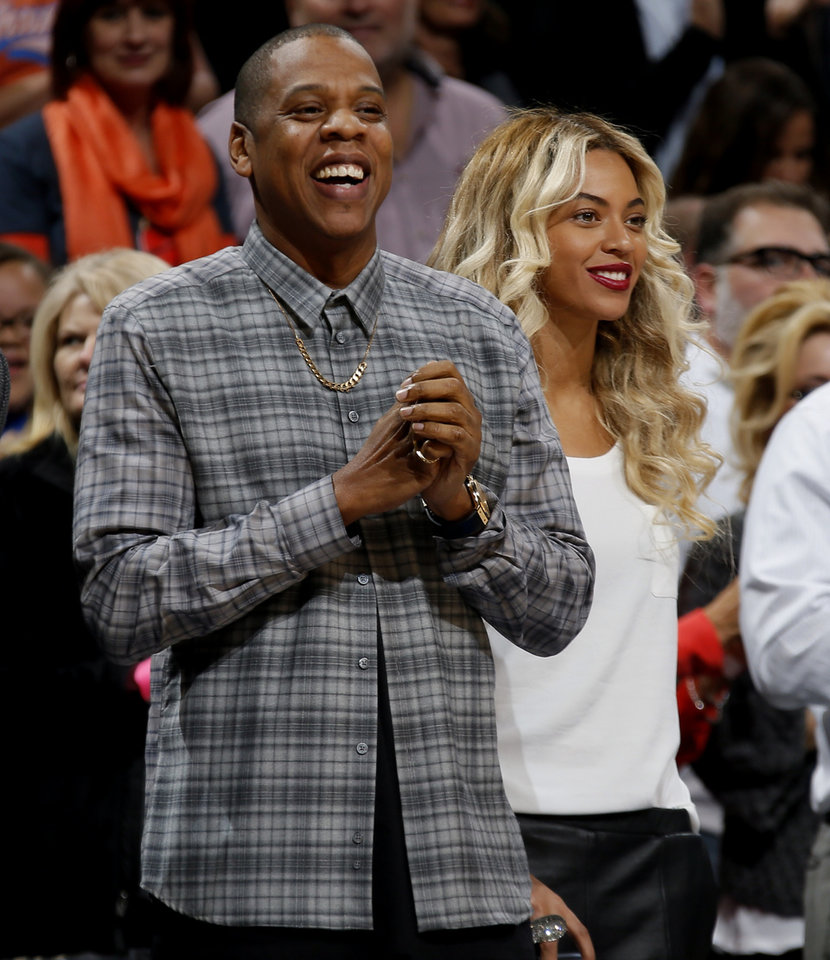 Jay Z and Beyonce watch during an NBA basketball game between the Oklahoma City Thunder and the Los Angeles Clippers at Chesapeake Energey Arena in Oklahoma City, Sunday, Nov. 3, 2013. Photo by Bryan Terry, The Oklahoman