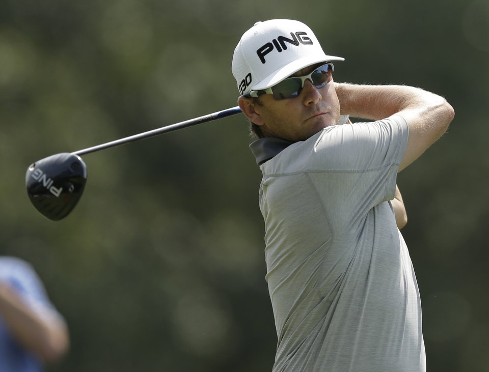 Photo - Heath Slocum watches his tee shot on the 18th hole during the second round of the Wyndham Championship golf tournament in Greensboro, N.C., Friday, Aug. 15, 2014. (AP Photo/Chuck Burton)